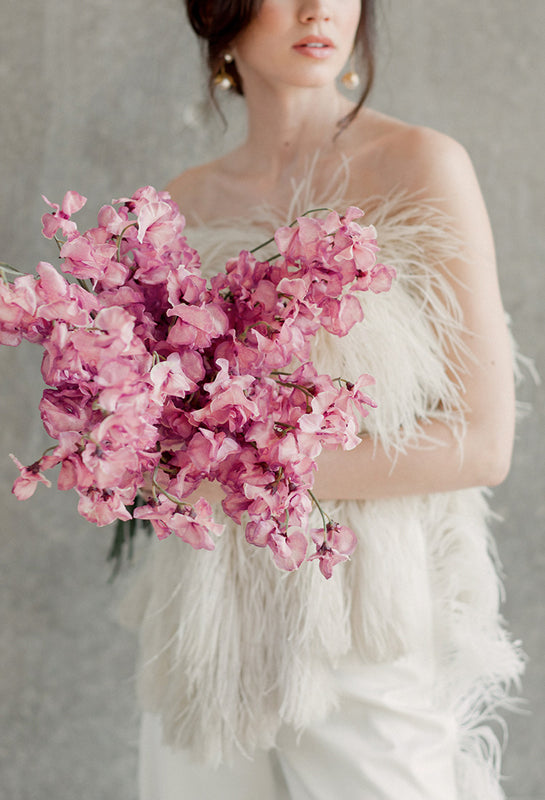 Sara Donaldson Photograph | Editorial featuring beautiful pink and violet tone bridal bouquet and ostrich feather top and pants. Bridal separates for a modern bride.