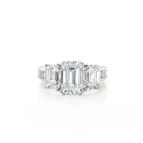 18CT WHITE GOLD THREE STONE EMERALD CUT RING WITH DIAMOND SET BAND