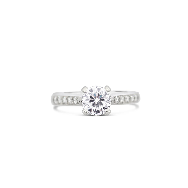 PLATINUM 1.08CT CENTO CUT DIAMOND AND PAVE SET ROUND BRILLIANT CUT DIAMOND RING