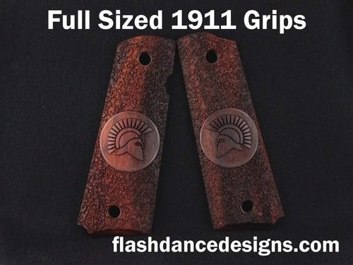 Cocobolo full sized 1911 grips laser engraved with a Spartan Helm over a stippled background