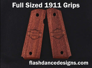Walnut full sized 1911 grips laser engraved with a motorcycle logo over a stippled background