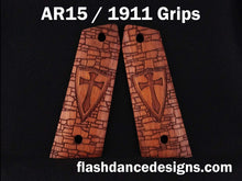 Load image into Gallery viewer, Walnut AR 1911 grips laser engraved with a crusader shield over a castle wall background