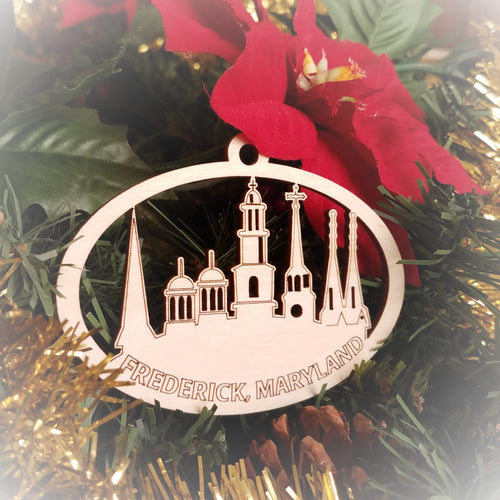 Laser engraved birch Christmas ornament featuring the Clustered Spires of Frederick, Maryland