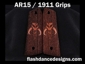 Walnut AR 1911 grips laser engraved with a popular bounty hunter logo over a stippled background