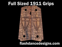 Load image into Gallery viewer, Walnut full sized 1911 grips laser engraved with a crusader shield over a castle wall background