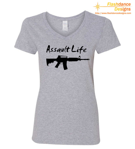 Silhouette of one of several modern military style rifles with the words Assault Life written above all printed on a heavy cotton ladie's v-neck tee. Available in multiple color combinations.