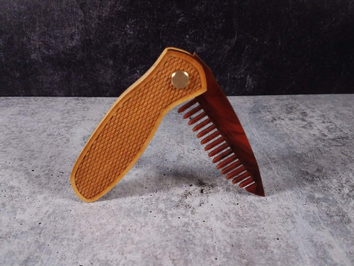 Folding tactical beard comb with a yellowheart handle, laser engraved with a Colt 1911 diamond pattern, and a tortoise shell acrylic blade.
