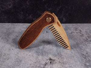 Folding tactical beard comb featuring a walnut handle laser engraved with a stipple pattern, and a bamboo ply blade