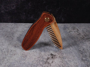 Folding tactical beard comb featuring a yellowheart handle laser engraved with a stipple design, and a bamboo ply blade