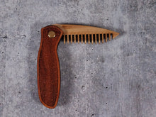 Load image into Gallery viewer, Folding tactical beard comb featuring a yellowheart handle laser engraved with a stipple design, and a bamboo ply blade