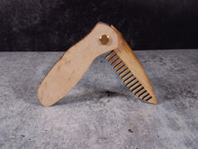 Load image into Gallery viewer, Folding tactical beard comb featuring a birdseye maple handle and a bamboo ply blade