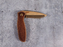 Load image into Gallery viewer, Folding tactical beard comb featuring a walnut handle laser engraved with a stipple pattern, and a bamboo ply blade