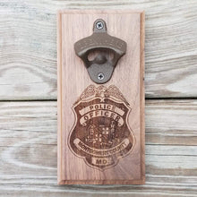 "Load image into Gallery viewer, Custom laser engraved hardwood bottle opener measuring 4"" x 8"". This example shows the Montgomery County MD police officer's badge. The bottle opener includes a rare earth magnet to hold bottle caps."