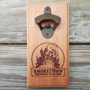 "Custom laser engraved hardwood bottle opener measuring 4"" x 8"". This example shows a local brewery's logo. The bottle opener includes a rare earth magnet to hold bottle caps."