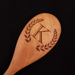 Beech wood spoon laser engraved with a customizable monogram and wreath