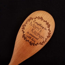 Load image into Gallery viewer, Customizable beech wood spoon laser engraved with Everything in Mom's Kitchen is Seasoned with Love inside a rustic wreath
