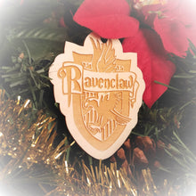 Load image into Gallery viewer, Laser engraved birch Christmas ornament with the Harry Potter Hogwarts House crest of Ravenclaw. Add custom engraved text to the back for a personalized touch.