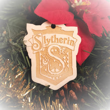 Load image into Gallery viewer, Laser engraved birch Christmas ornament with the Harry Potter Hogwarts House crest of Slytherin. Add custom engraved text to the back for a personalized touch.