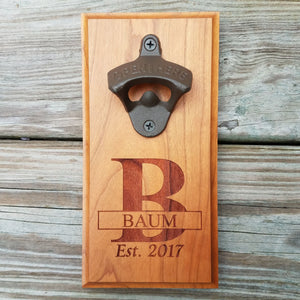 "Hardwood bottle opener measuring 4"" x 8"", laser engraved with a custom monogram and year. The bottle opener includes a rare earth magnet to hold bottle caps."