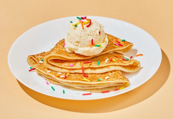 Crepes topped with ice cream and sprinkles