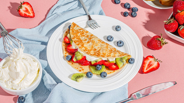 Whipped cream and fresh fruit crepes