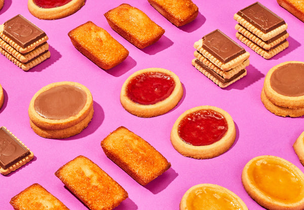 Variety of French cookies over a purple backdrop