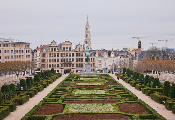 Image of garden and famous building in Brussels with a gloomy sky.