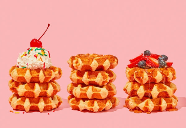 Stacks of Belgian waffles with various toppings