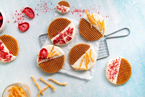 White chocolate dipped stroopwafels with orange zest