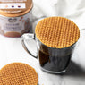 An authentic Dutch Caramel Stroopwafel on a cup of coffee for a melted caramel effect