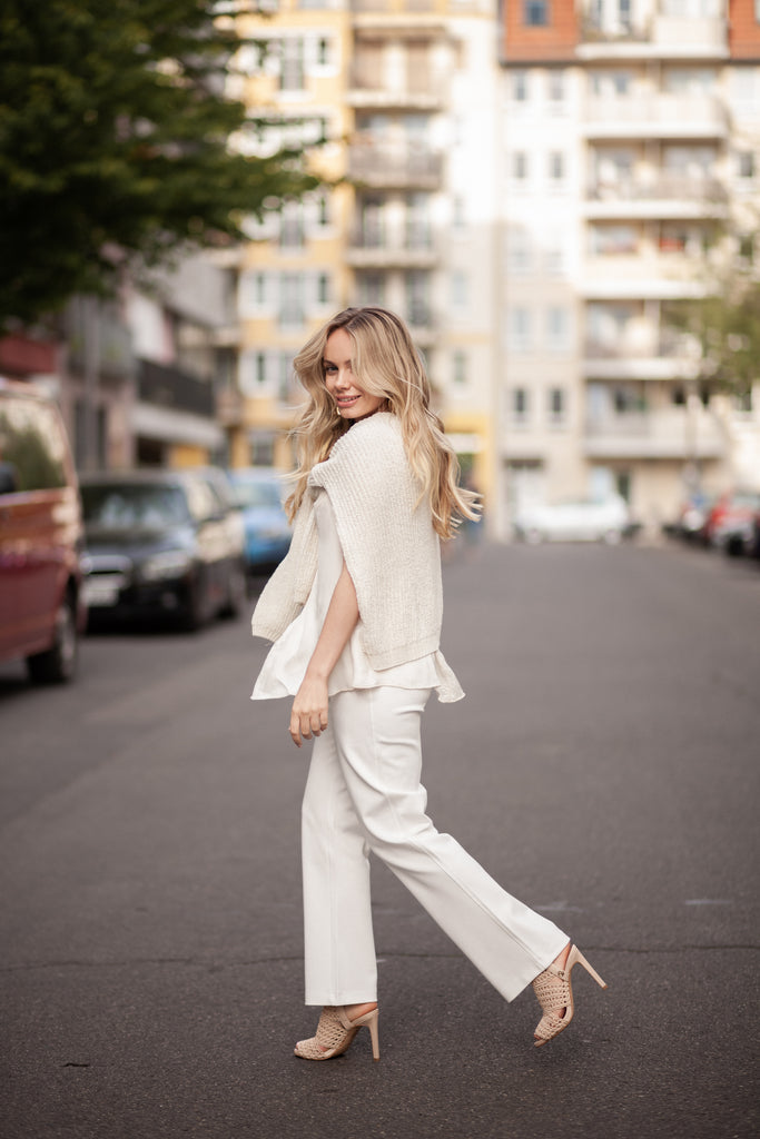 blond girl wearing suluu.store clothing items, total white look