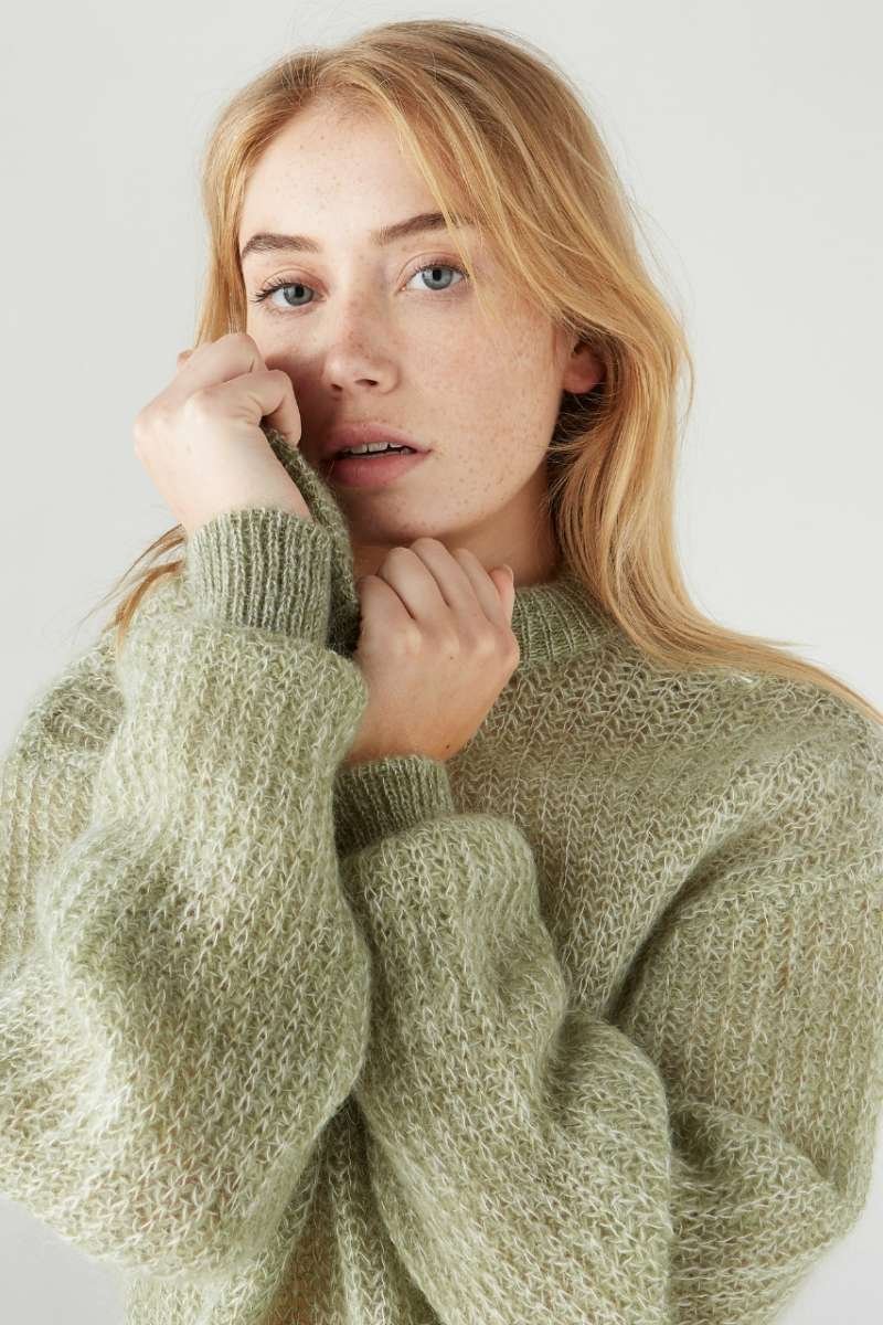 Sweater in melange green color made of mohair