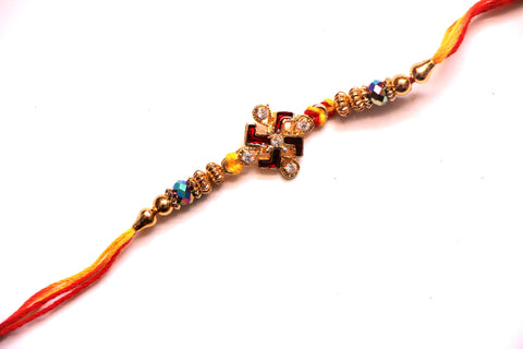 Red Swastik Rakhi with gold beads - OnlinePrasad.com