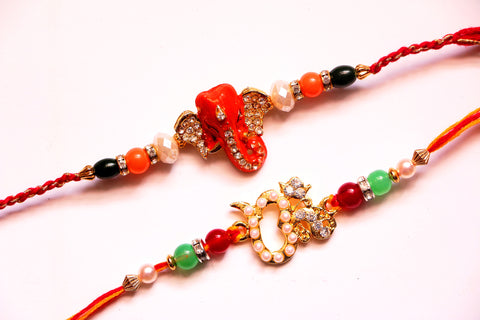 Combo rakhi pack of orange Ganesha and pearl Om - OnlinePrasad.com