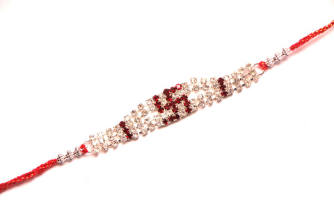Swastik  Rakhi in Red with White Crystals - OnlinePrasad.com