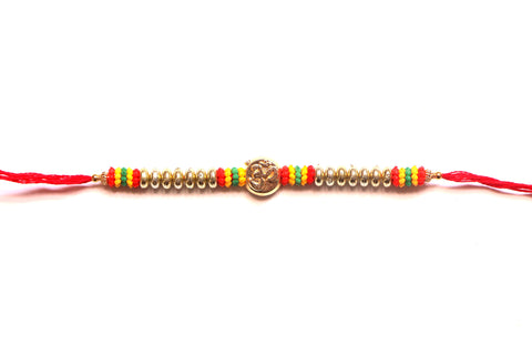 Om Rakhi in gold with colorful beads - OnlinePrasad.com
