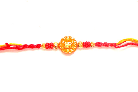 Swastik rakhi in orange and gold - OnlinePrasad.com