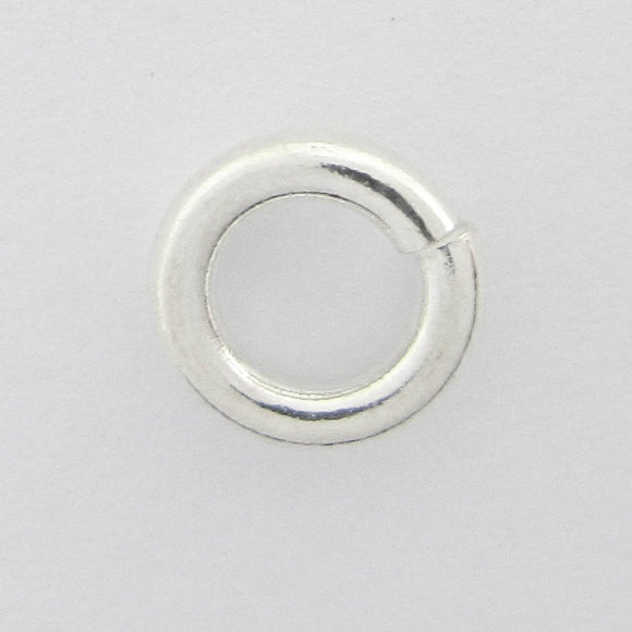 Sterling sil 7x1.5mm jumpring 4pcs