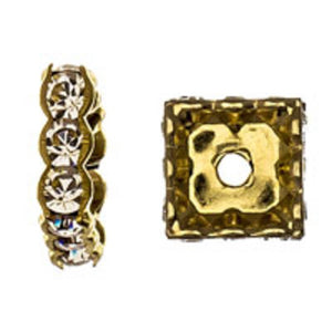 Swarovski 10mm 77610 gold/clr 2pcs