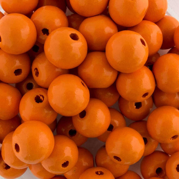 Wood 10mm rnd 2mm hole tangerine 100pc