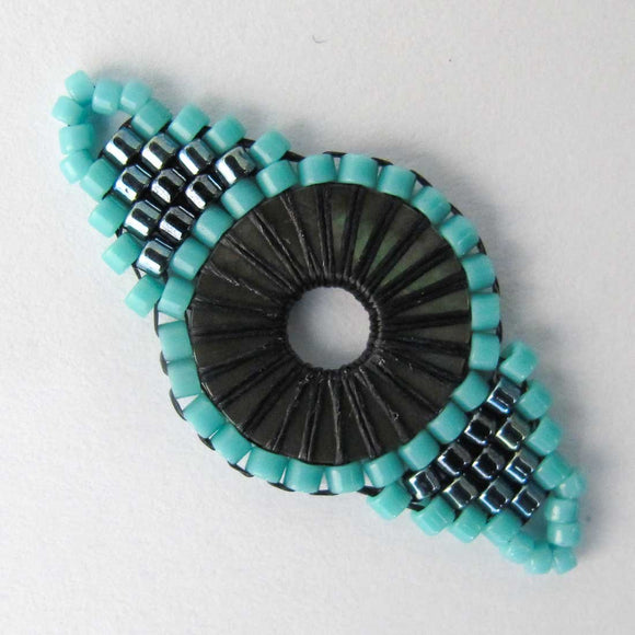 Delica 35mm Mandala Eye teal 1pc