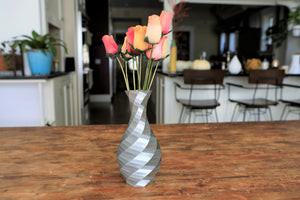 silver geometric vase with flowers