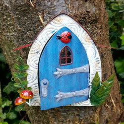 blue-metal-ladybird-fairy-door