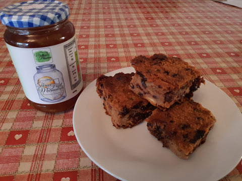 Marmalade jar next to bread pudding squares on a plate