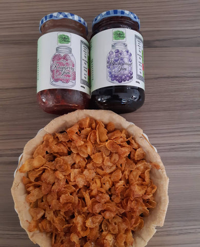 Cornflake Tart with jars of Matthew's Preserves Blackcurrant Jam and Raspberry Jam