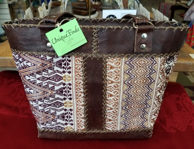 Handmade leather and woven fabric tote bag
