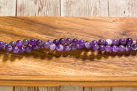 "Matte Dog Teeth Amethyst - 8mm - Round - 8"" Strand"