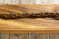"Matte Tiger Eye - 4mm - Round - 15-16"" Strand"