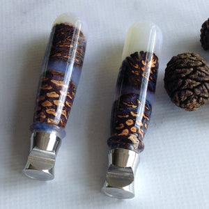 handcrafted bottle opener with resin and pine cones by Michael's Woodcrafts Greenville SC woodworkers Woodworking