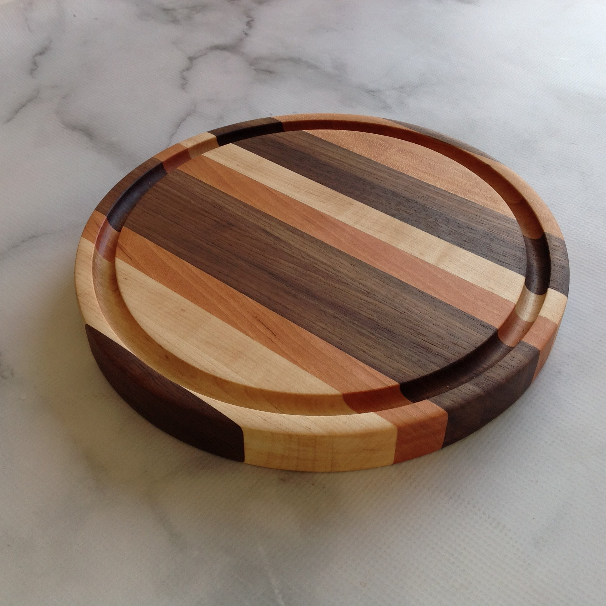 Round cutting board with juice groove, Walnut, Maple and Cherry by Michael's Woodcrafts Greenville SC